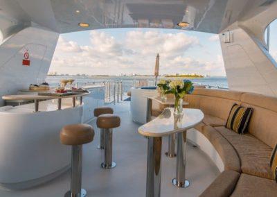 102 Azimut charter yacht flybridge dinette and bar