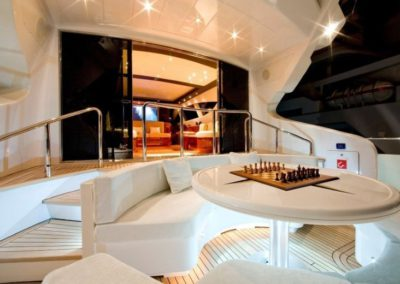 105 Mangusta yacht aft deck dining table