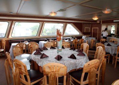 142 Swiftship yacht dining table arrangement