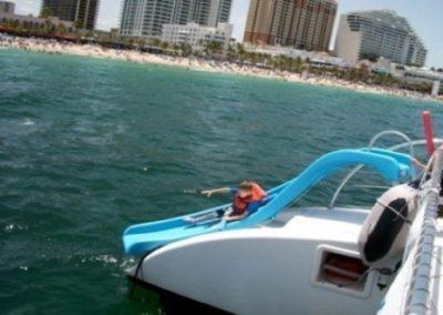 50 Sailing party catamaran on anchor by Miami Beach