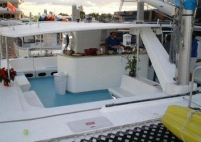 50 Sailing party catamaran deck with food and drink service