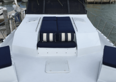 80 Hatteras party yacht bow seating and sunpads