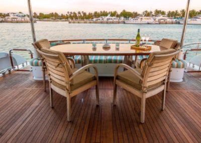 84 Lazzara yacht aft deck dining