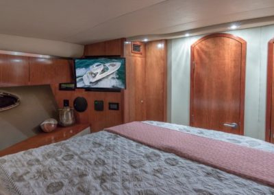 42 Cruisers yacht master cabin with entertainment system