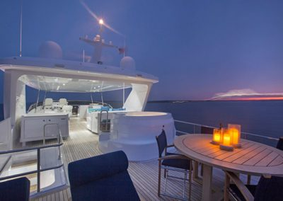 102 Hatteras yacht flybridge night dining