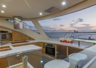 62 Power Catamaran galley dining