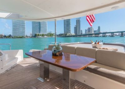 62 Power Catamaran aft deck dining