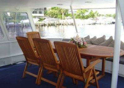 91 Striker party yacht aft deck dining table