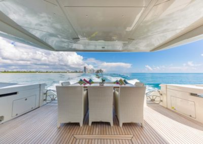 80 Dominator yacht aft deck dining