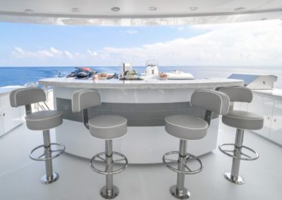 120 Trinity yacht flybridge dinette and bar